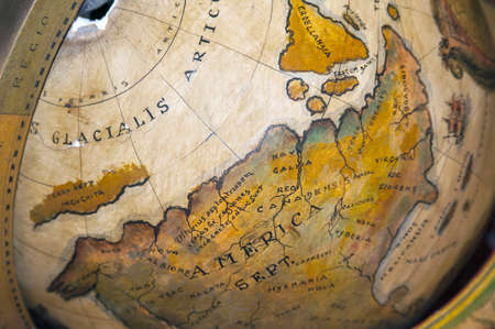 artic circle: A vintage wooden world map globe Stock Photo