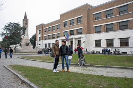 A high school with some students outside
