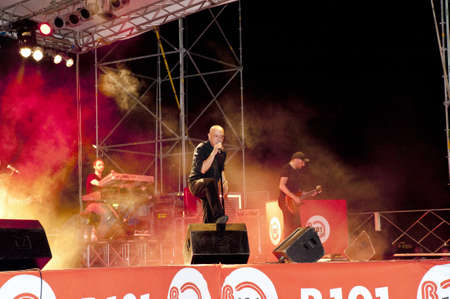 The singer Enrico Ruggeri on stage during a concert