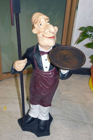 busboy: A statue of a waiter