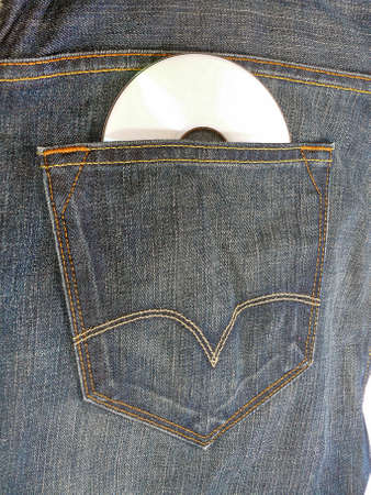 allusion: Blue-jeans with a CD hanging out of the pocket Stock Photo