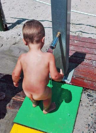 Child near a fountain