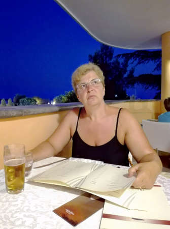 dinnertime: Woman with menu