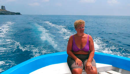 Woman on a motor boat