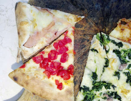 dinnertime: Slices of different pizzas
