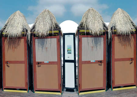 shower stall: Straw cabins at beach resort