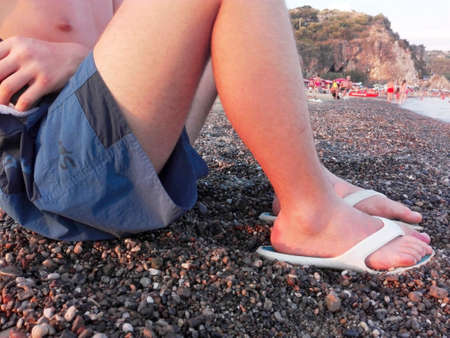 foreshore: A boy sat on the foreshore Stock Photo