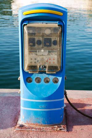 dockside: A gasoline  dispenser on the jetty