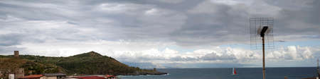 blustery: Panoramic view of a bay with a cloudy sky