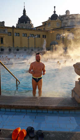 Young guy enjoying spa baths in the evening, Budapest photo