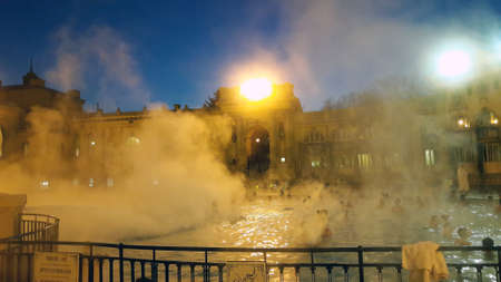 People in the Széchenyi spa baths in the evening, Budapest