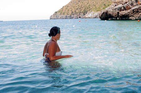 dipping: Girl going for a dip