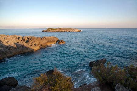 islet: Rocky coast with islet