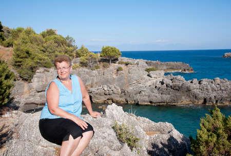 Woman sat on a rock for a portrait Stock Photo