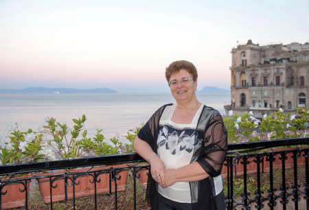 Portrait of a woman on a panoramic terrace, Posillipo, Naples, Italy