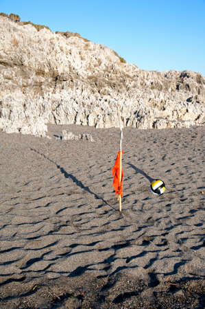 gravelly: A signal and a volleyball on the beach Stock Photo