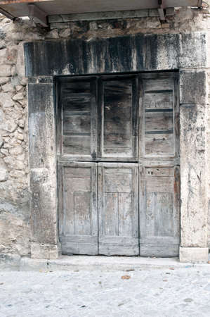 An ancient door in the mountain hamlet of Pescocostanzo, Aquila, Italy Stock Photo