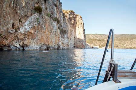Yachting along the rocky coast, Palinuro, Italy Stock Photo