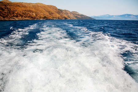 Waves behind boat underway Stock Photo