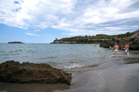 Family having fun at beach along a beautiful inlet Stock fotó
