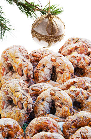"""Tray with Neapolitan traditional cookies called """"Roccocò"""" near a Christmas tree."""