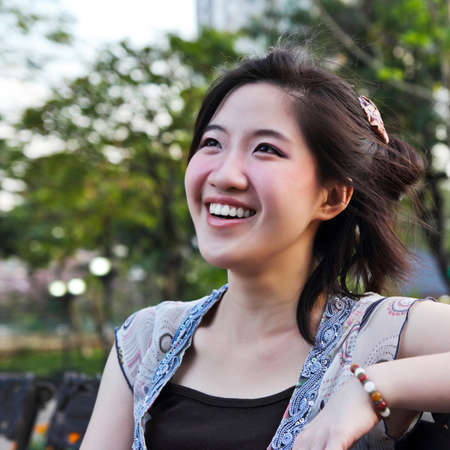 Asian woman smiling happily in the park. photo
