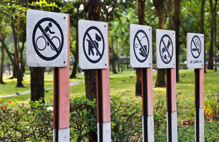Warning signs in the park Stock Photo - 12047310