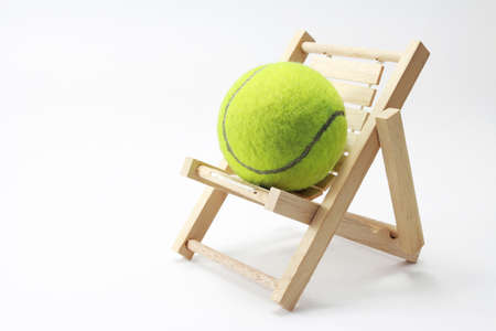 Tennis and chair on white background Stock Photo