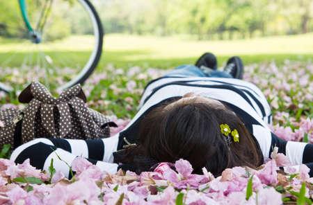 Asian woman sleeping on the grass photo