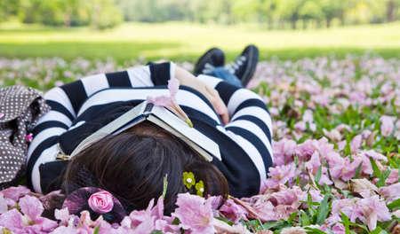 collegian: Asian woman sleeping on the grass Stock Photo
