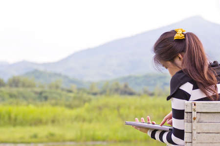 Young woman using tablet at mountain view  photo