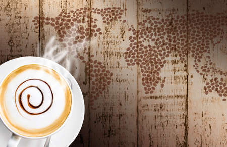 Coffee cup and saucer wood background photo
