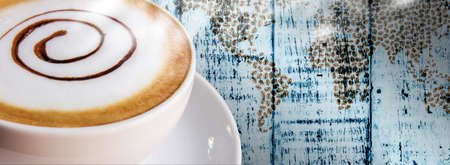 Coffee cup and saucer on vintage wood background  photo