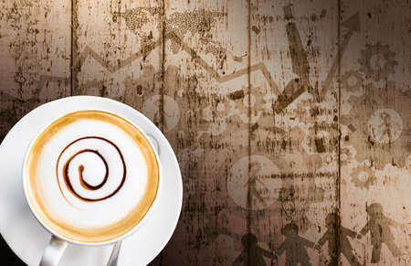 Coffee cup and saucer on wood background  Business concepts  photo