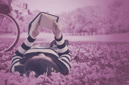 collegian: Asian woman reading booklet on the grass  Vintage style