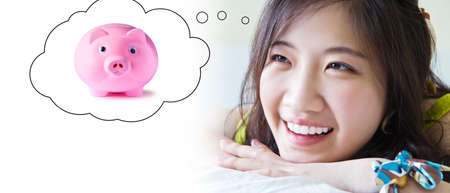 bedchamber: Asian woman thinking piggy bank  Concepts for saving money   Stock Photo