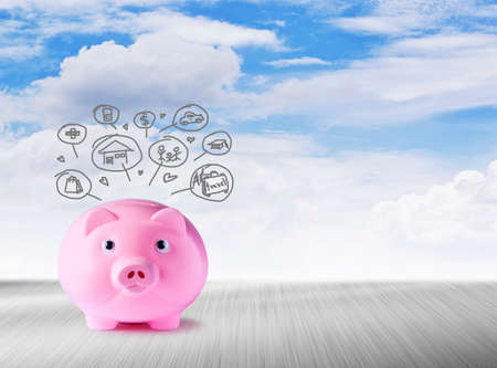 Pink piggy bank and icons design to represent the concept of saving money  photo