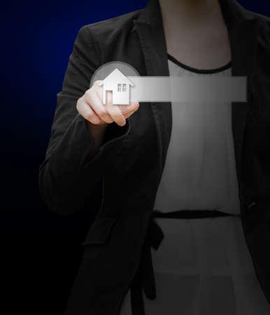 Business woman hand selecting home botton photo