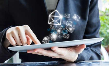 Businesswoman sending email Stock fotó