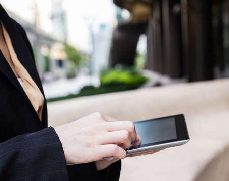Businesswoman using digital tablet photo