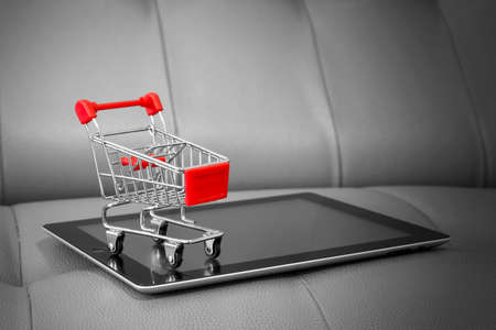 cart: Shopping cart on digital tablet. Shopping online concept. Stock Photo