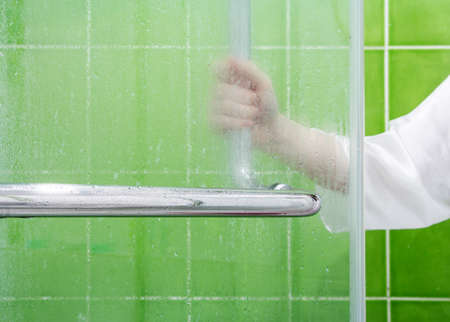 glass partition: Young woman open glass partition in the bathroom Stock Photo