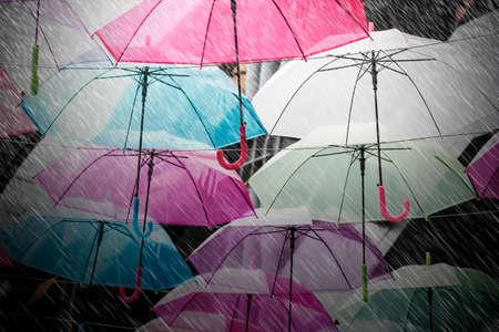 Colorful umbrellas decoration in rainy day