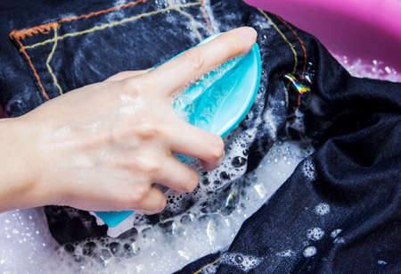 hand washing: Woman is washing blue jean