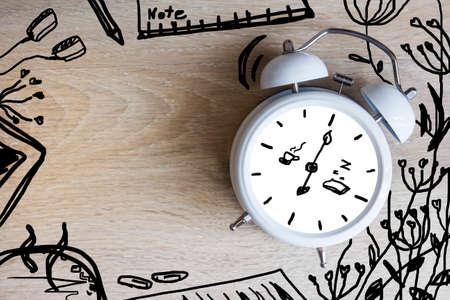 black coffee: Alarm clock with sketch design on the desk