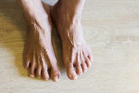 sere: Old feet on wooden floor