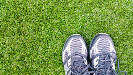turf: Sport shoes on artificial turf Stock Photo