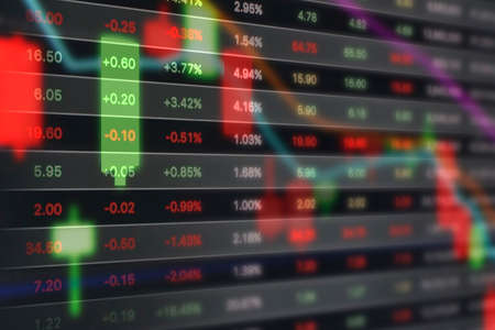 Stock market graph on digital tablet 版權商用圖片