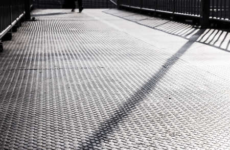 people shadow: Texture metal on the overpass