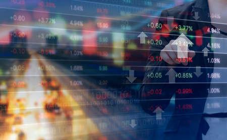 ビジネスの女性と株式市場のグラフの二重露光 写真素材